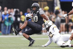 Vanderbilt tight end Jared Pinkney (80) is brought down by Missouri safety Joshuah Bledsoe (18) in the first half of an NCAA college football game Saturday, Oct. 19, 2019, in Nashville, Tenn. (AP Photo/Mark Humphrey)