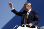 President Donald Trump arrives at Moffett Federal Airfield to attend a fundraiser, Tuesday, Sept. 17, 2019, in Mountain View, Calif. (AP Photo/Evan Vucci)