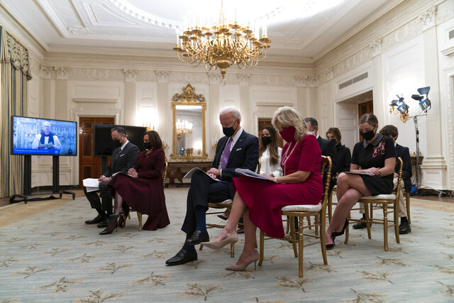 Doug Emhoff, left, Vice President Kamala Harris, President Joe Biden, and first lady Jill Biden, bow their heads in prayer during a virtual Presidential Inaugural Prayer Service, in the State Dinning Room of the White House, Thursday, Jan. 21, 2021, in Washington. (AP Photo/Alex Brandon)