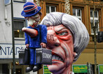 A carnival float depicts British Prime Minister Theresa May and the Brexit prior to the traditional carnival parade in Duesseldorf, Germany, on Monday, March 4, 2019. The foolish street spectacles in the carnival centers of Duesseldorf, Mainz and Cologne, watched by hundreds of thousands of people, are the highlights in Germany's carnival season on Rosemonday. (AP Photo/Martin Meissner)