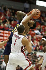 California guard Paris Austin (3) is fouled by Washington State guard Jervae Robinson (1) during the second half of an NCAA college basketball game in Pullman, Wash., Wednesday, Feb. 19, 2020. Robinson fouled out. California won 66-57. (AP Photo/Young Kwak)