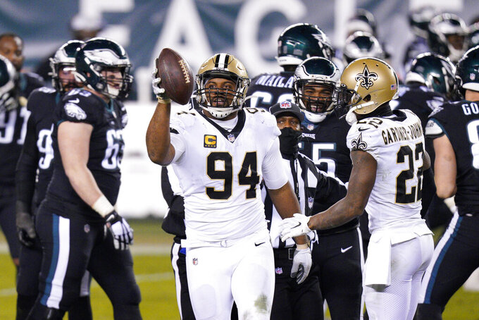 New Orleans Saints' Cameron Jordan (94) reacts after a fumble by Philadelphia Eagles' Jalen Hurts during the second half of an NFL football game, Sunday, Dec. 13, 2020, in Philadelphia. (AP Photo/Chris Szagola)