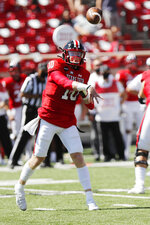 Texas Tech quarterback Alan Bowman passes downfield during the first half of an NCAA college football game against Texas Tech, Saturday Sept. 26, 2020, in Lubbock, Texas. (AP Photo/Mark Rogers)