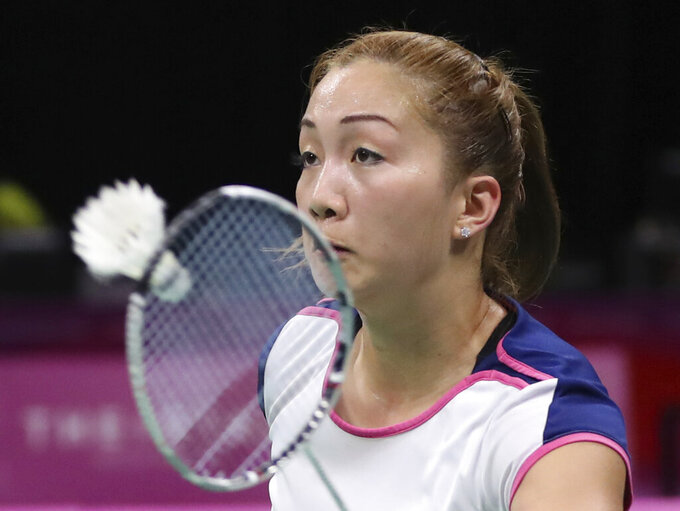 FILE - In this April 11, 2018 file photo, Kate Foo Kune of Mauritius plays against Sri Lanka's Sri Hasini Ambalangodage during their women's singles badminton match at Carrara Indoor Stadium during the Commonwealth Games on the Gold Coast, Australia. Four-time African badminton champion Kune has been banned for 2 years in a doping case, the ban began Tuesday, Dec. 15, 2020. (AP Photo/Dita Alangkara, file)