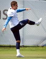 FILE - In this Wednesday, Sept. 9, 2020, file photo, Tennessee Titans kicker Stephen Gostkowski (3) follows through after kicking a ball during NFL football practice in Nashville, Tenn. Playing for a team other than the New England Patriots for the first time since entering the NFL in 2006 definitely feels a bit odd for kicker Stephen Gostkowski.  (George Walker IV/The Tennessean via AP, Pool, File)
