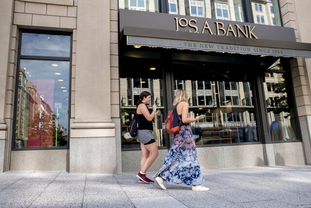 A JoS. A. Bank clothing chain location in Washington, Monday, Aug. 3, 2020. Tailored Brands, known for its clothing chains Men's Wearhouse and JoS. A. Bank, struggled as the pandemic shut stores and consumer demand for office attire dropped, has filed for bankruptcy. (AP Photo/Andrew Harnik)
