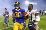 Los Angeles Rams running back Todd Gurley, left, and Chicago Bears defensive back Sherrick McManis meet on the field after an NFL football game Sunday, Nov. 17, 2019, in Los Angeles. The Rams won 17-7. (AP Photo/Mark J. Terrill)