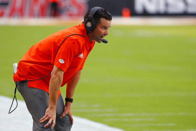 Miami head coach Manny Diaz watches a play from the sideline during the first half of an NCAA college football game against Bethune-Cookman, Saturday, Sept. 14, 2019, in Miami Gardens, Fla. (AP Photo/Wilfredo Lee)