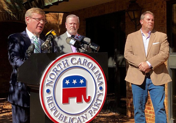 FILE - North Carolina House Speaker Tim Moore, left, R-Cleveland, speaks to reporters, with Senate leader Phil Berger, R-Rockingham, and House Majority Leader John Bell, right, R-Wayne, at a news conference on Wednesday, Nov. 4, 2020 at state GOP headquarters in Raleigh, N.C., to discuss Election Day results.  North Carolina Democrats were hoping this November they would break the backs of Republicans, who, after dominating state politics for much of the past decade, saw their power erode in the 2016 and 2018 elections. Instead, state Democrats had little to tout after Election Day beyond Gov. Roy Cooper's close yet expected reelection, a narrow victory for Attorney General Josh Stein, and picking up two U.S. House seats largely handed to them by redistricting in 2019. (AP Photo/Gary D. Robertson, FILE).
