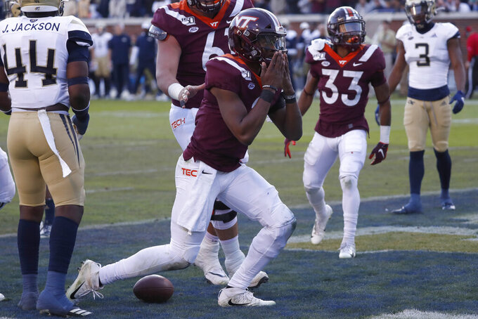 Virginia Tech quarterback Hendon Hooker (2) recast after scoring a touchdown on a short run in the first half of an NCAA football game against the Georgia Tech Saturday, Nov. 16, 2019, in Atlanta. (AP Photo/John Bazemore)