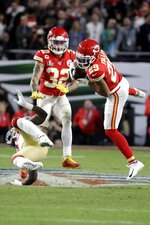 Kansas City Chiefs' Kendall Fuller (29) intercepts a pass next to San Francisco 49ers' Deebo Samuel, bottom, during the second half of the NFL Super Bowl 54 football game Sunday, Feb. 2, 2020, in Miami Gardens, Fla. The Kansas City Chiefs won 31-20. (AP Photo/Wilfredo Lee)