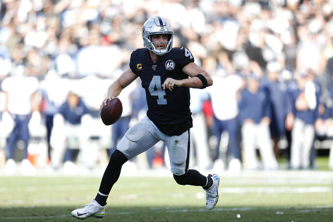 Oakland Raiders quarterback Derek Carr (4) rolls out to pass against the Tennessee Titans during the first half of an NFL football game in Oakland, Calif., Sunday, Dec. 8, 2019. (AP Photo/D. Ross Cameron)