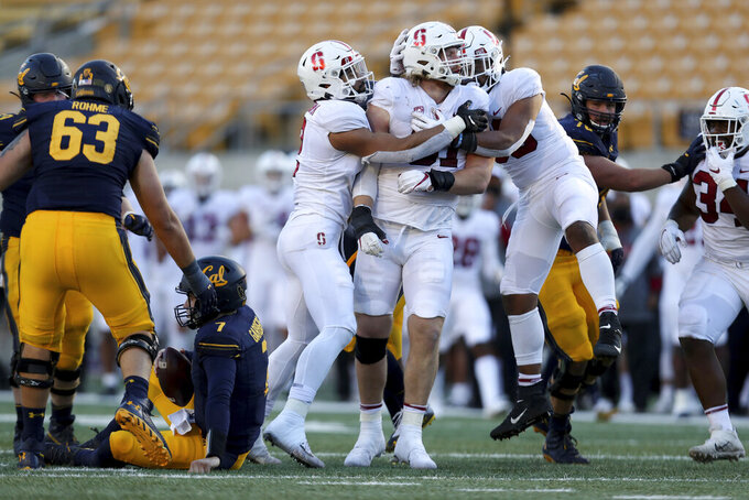 Stanford linebacker Thomas Schaffer, center, celebrates after sacking California quarterback Chase Garbers, on ground during the second half of an NCAA college football game Friday, Nov. 27, 2020, in Berkeley, Calif. (AP Photo/Jed Jacobsohn)