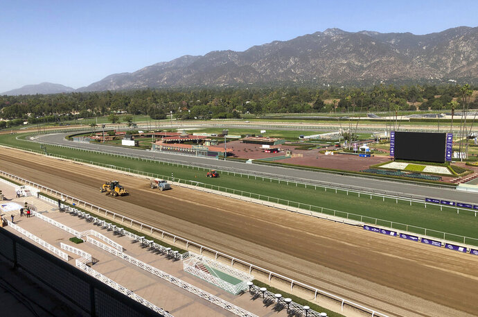 The track is prepared at Santa Anita Park in Arcadia, Calif., Wednesday, Oct. 30, 3019.  A tragic, wild and unusual year in horse racing culminates with the Breeders' Cup world championships this weekend at Santa Anita, where the fatalities have prompted investigations, outrage from the public, and animal rights activists demanding the end of racing in California. (AP Photo/Beth Harris)