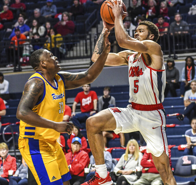 Mississippi forward KJ Buffen (5) makes a basket and is fouled by Cal State Bakersfield forward Shawn Stith (32)  during an NCAA college basketball game, Saturday, Dec, 7, 2019, in Oxford, Miss. (Bruce Newman/The Oxford Eagle via AP)