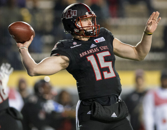 FILE - In this Dec. 6, 2017, file photo, Arkansas State quarterback Justice Hansen (15) throws against Middle Tennessee during the first half of the Camellia Bowl NCAA college football game,  in Montgomery, Ala. The Red Wolves have earned at least a share of the Sun Belt title five of the last seven years and are the preseason pick to win it again. Arkansas State had six first-team preseason all-Sun Belt selections, and quarterback Justice Hansen was named preseason offensive player of the year. (Mickey Welsh/The Montgomery Advertiser via AP, File)