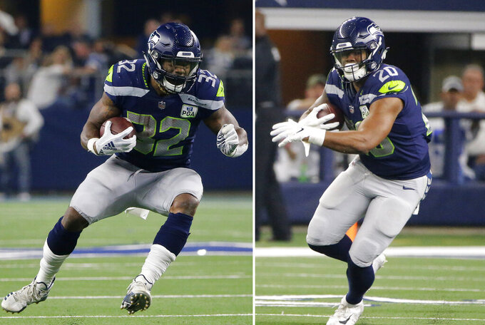 FILE - At left, in a Jan. 5, 2019, file photo, Seattle Seahawks running back Chris Carson (32) runs against the Dallas Cowboys during the first half of the NFC wild-card NFL football game in Arlington, Texas. At right, also in a Jan. 5, 2019, file photo, Seattle Seahawks running back Rashaad Penny (20) carries the ball against the Dallas Cowboys during the NFC wild-card NFL football game in Arlington, Texas. Despite rushing for more than a 1,100 yards last season there's a good chance Chris Carson finds himself sharing the workload in Seattle's backfield with Rashaad Penny. And Carson sounds just fine with that. (AP Photo/Michael Ainsworth, File)