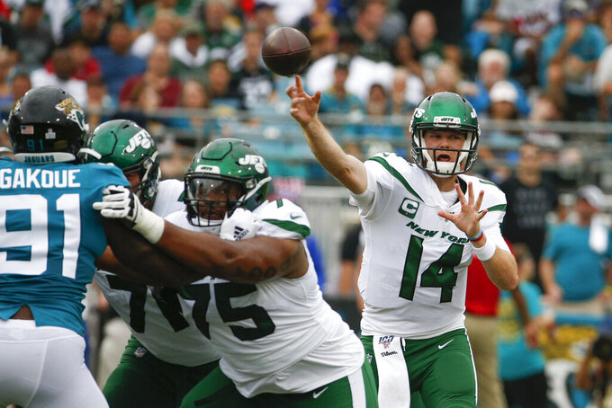 New York Jets quarterback Sam Darnold (14) throws a pass against the Jacksonville Jaguars during the first half of an NFL football game, Sunday, Oct. 27, 2019, in Jacksonville, Fla. (AP Photo/Stephen B. Morton)