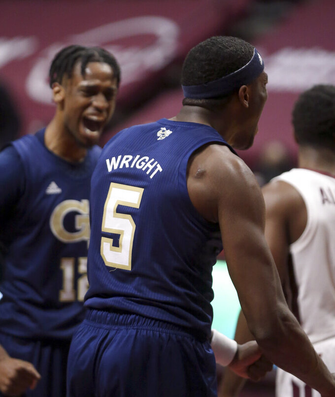 Georgia Tech's Moses Wright (5) and Khalid Moore (12) celebrate a score during the second half of an NCAA college basketball game against Virginia Tech Tuesday, Feb. 23, 2021, in Blacksburg, Va. (Matt Gentry/The Roanoke Times via AP, Pool)