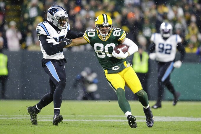 Green Bay Packers' Jimmy Graham catches a pass in front of Carolina Panthers' Eric Reid during the first half of an NFL football game Sunday, Nov. 10, 2019, in Green Bay, Wis. (AP Photo/Jeffrey Phelps)