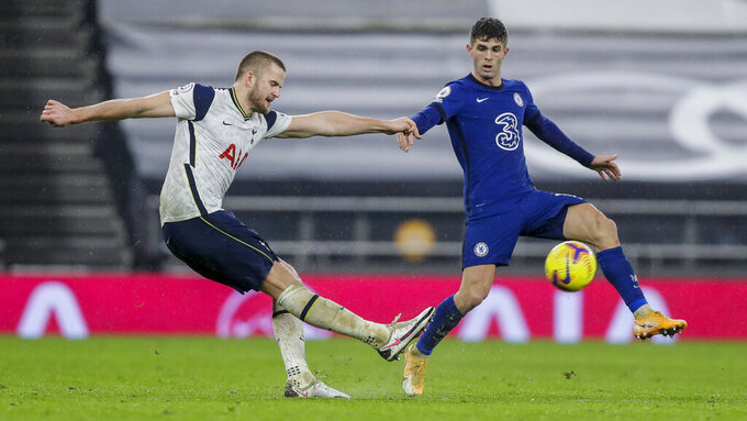 Chelsea's Christian Pulisic, right, and Tottenham's Eric Dier duel for the ball during the English Premier League soccer match between Tottenham and Chelsea at the Tottenham Hotspur Stadium in London, England, Thursday, Feb. 4, 2021. (Kirsty Wigglesworth/Pool via AP)