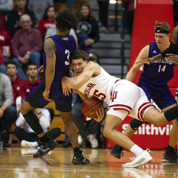 Indiana's Race Thompson (25) collides into the back of North Alabama's Jamari Blackmon (3) as he comes down with a rebound during the second half of an NCAA college basketball game, Tuesday, Nov. 12, 2019, in Bloomington, Ind. Indiana won 91-65. (AP Photo/Doug McSchooler)