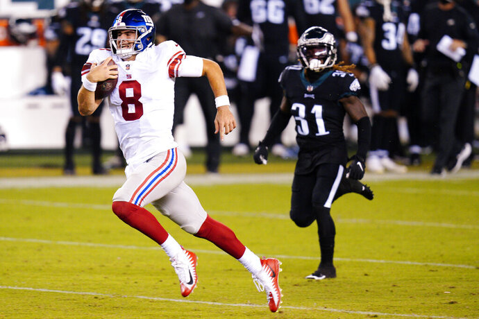 New York Giants' Daniel Jones runs with the ball during the second half of an NFL football game against the Philadelphia Eagles, Thursday, Oct. 22, 2020, in Philadelphia. (AP Photo/Chris Szagola)