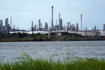A refinery is seen along the water, Wednesday, Aug. 26, 2020, in Port Arthur, Texas. The energy industry is bracing for catastrophic storm surges and winds as Hurricane Laura cuts a dangerous path toward the coastlines of Texas and Louisiana.(AP Photo/Eric Gay)