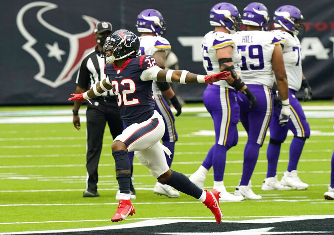 Houston Texans cornerback Lonnie Johnson (32) celebrates after the Minnesota Vikings missed a field goal attempt during the second half of an NFL football game Sunday, Oct. 4, 2020, in Houston. (AP Photo/David J. Phillip)