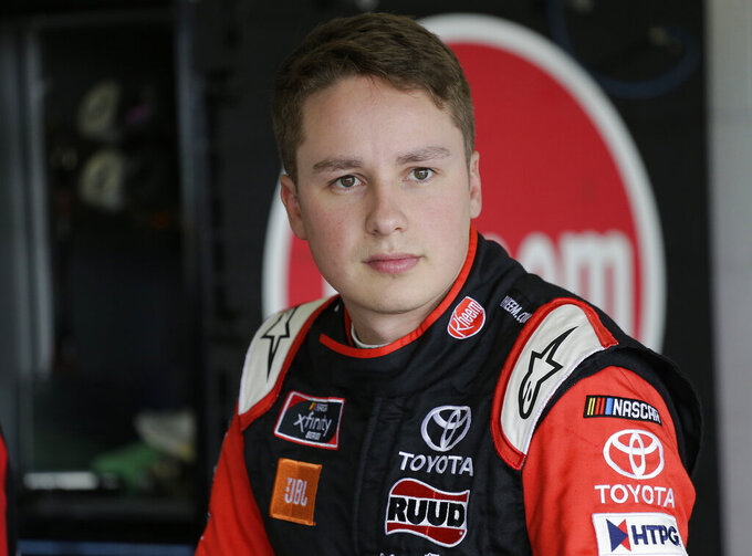 Christopher Bell looks on in the garage before a NASCAR Xfinity Series auto race practice on Friday, Nov. 15, 2019, at Homestead-Miami Speedway in Homestead, Fla. Bell is one of four drivers racing for the series championship. (AP Photo/Terry Renna)