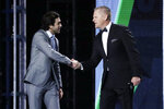 NASCAR driver Chase Elliott, left, is named the most popular driver at the NASCAR Cup Series Awards Thursday, Dec. 5, 2019, in Nashville, Tenn. (AP Photo/Mark Humphrey)