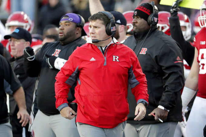 Rutgers head coach Chris Ash, center, looks on from the sideline during the first half of an NCAA college football game against Michigan, Saturday, Nov. 10, 2018, in Piscataway, N.J. (AP Photo/Julio Cortez)