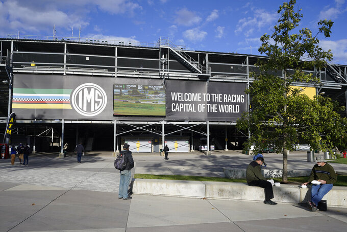 Fans arrive for a practice session for the IndyCar auto race at Indianapolis Motor Speedway, Thursday, Oct. 1, 2020, in Indianapolis. (AP Photo/Darron Cummings)