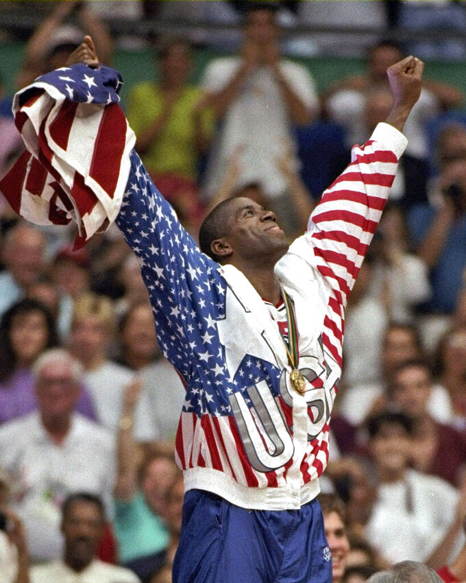 "FILE - In this Aug. 8, 1992, file photo, USA's Earvin ""Magic"" Johnson rejoices with his gold medal after beating Croatia 117-85 in the gold medal game in men's basketball at the Summer Olympics in Barcelona. (AP Photo/Susan Ragan, File)"