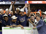 Virginia head coach Tony Bennett celebrates with his team after defeating Texas Tech 85-77 in the overtime in the championship of the Final Four NCAA college basketball tournament, Monday, April 8, 2019, in Minneapolis. (AP Photo/Matt York)