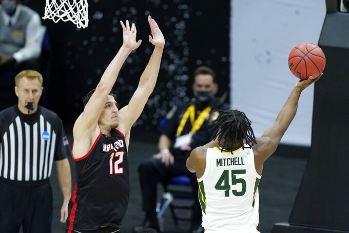 Baylor's Davion Mitchell (45) shoots against Hartford's Miroslav Stafl (12) during the first half of a college basketball game in the first round of the NCAA tournament at Lucas Oil Stadium in Indianapolis Friday, March 19, 2021, in Indianapolis, Tenn. (AP Photo/Mark Humphrey)