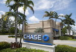 FILE - This Wednesday, Aug. 17, 2016, file photo, shows a Chase bank branch in North Miami Beach, Fla. JPMorgan Chase & Co. reports earnings, Friday, Jan. 12, 2018. (AP Photo/Wilfredo Lee, File)