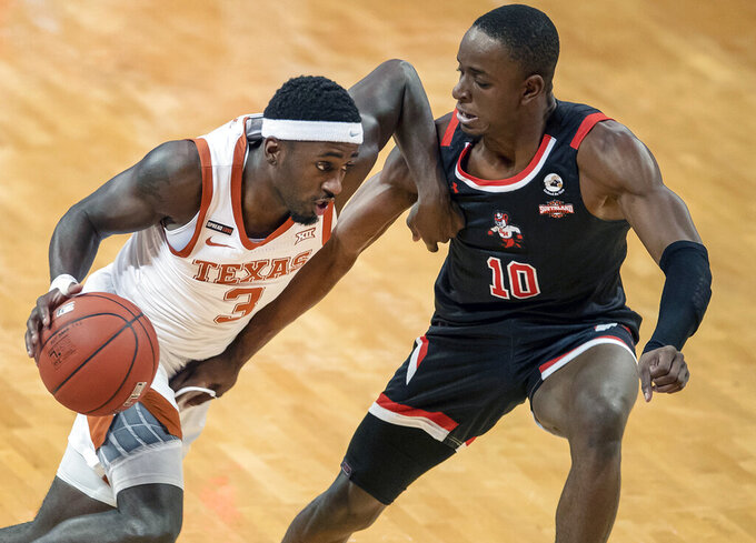 Texas guard Courtney Ramey (3) drives the ball against Sam Houston State guard Zach Nutall (10) during the first half of an NCAA college basketball game, Wednesday, Dec. 16, 2020 in Austin, Texas. (Ricardo B. Brazziell/Austin American-Statesman via AP)