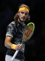 Stefanos Tsitsipas of Greece celebrates winning the first set against Roger Federer of Switzerland during their ATP World Tour Finals semifinal tennis match at the O2 Arena in London, Saturday, Nov. 16, 2019. (AP Photo/Kirsty Wigglesworth)