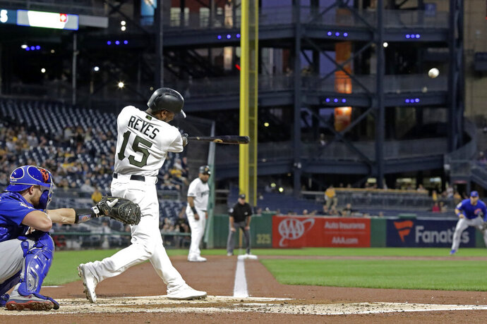 Pittsburgh Pirates' Pablo Reyes (15) drives in two runs with a triple off Chicago Cubs starting pitcher Jose Quintana during the first inning of a baseball game in Pittsburgh, Thursday, Sept. 26, 2019. (AP Photo/Gene J. Puskar)