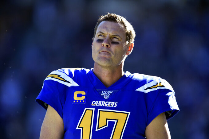 Los Angeles Chargers quarterback Philip Rivers looks on during the first half of an NFL football game against the Minnesota Vikings, Sunday, Dec. 15, 2019, in Carson, Calif. (AP Photo/Kelvin Kuo)