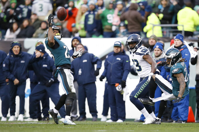 Philadelphia Eagles' Rodney McLeod (23) intercepts a pass as Seattle Seahawks' David Moore (83) and Ronald Darby (21) look on during the second half of an NFL football game, Sunday, Nov. 24, 2019, in Philadelphia. (AP Photo/Michael Perez)