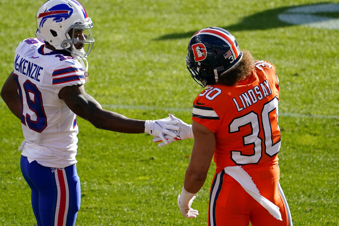 Buffalo Bills wide receiver Isaiah McKenzie, left, greets Denver Broncos running back Phillip Lindsay before an NFL football game Saturday, Dec. 19, 2020, in Denver. (AP Photo/Jack Dempsey)