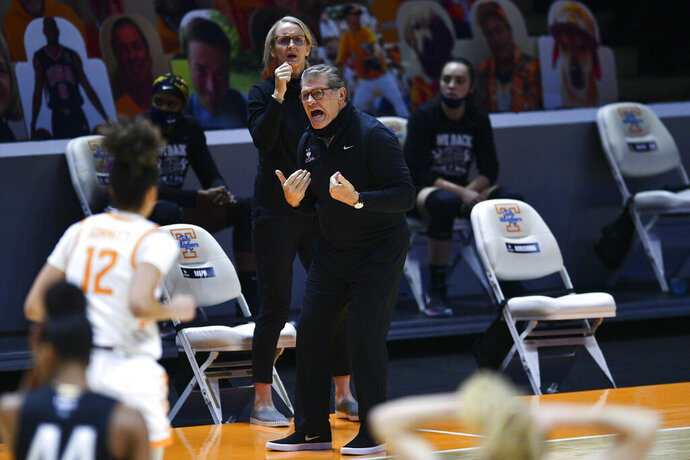Connecticut coach Geno Auriemma shouts during the team's NCAA college basketball game against Tennessee in Knoxville, Tenn., Thursday, Jan. 21, 2021. (Saul Young/Knoxville News Sentinel via AP, Pool)