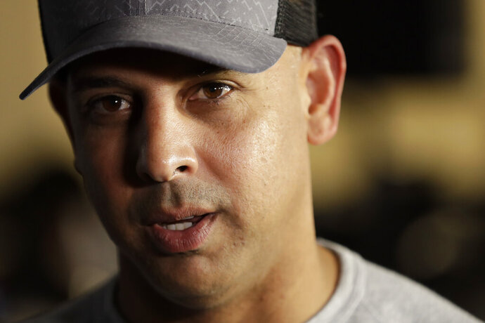 FILE - In this Dec. 9, 2019, file photo, then-Boston Red Sox manager Alex Cora speaks during the Major League Baseball winter meetings in San Diego. The Boston Red Sox were stripped of their second-round pick in this year's amateur draft by Major League Baseball for breaking video rules in 2018 and former manager Alex Cora was suspended through the 2020 postseason for his conduct as bench coach with the Houston Astros the previous year. Baseball Commissioner Rob Manfred announced his decision Wednesday, April 22, 2020, concluding Red Sox replay system operator J.T. Watkins used in-game video to revise sign sequences provided to players. (AP Photo/Gregory Bull, File)