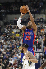 Detroit Pistons' Wayne Ellington (20) puts up a shot against Indiana Pacers' Cory Joseph (6) during the first half of an NBA basketball game, Monday, April 1, 2019, in Indianapolis. (AP Photo/Darron Cummings)