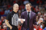 Massachusetts head coach Matt McCall, right, argues a call during the first half of an NCAA college basketball game against Dayton, Saturday, Jan. 11, 2020, in Dayton. (AP Photo/John Minchillo)