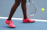 United States' Coco Gauff, shown with a tribute to Kobe Bryant written on her shoes as she prepares to serve during her doubles match with compatriot Caty McNally against Japan's Shuko Aoyama amd Ena Shibahara at the Australian Open tennis championship in Melbourne, Australia, Monday, Jan. 27, 2020. (AP Photo/Dita Alangkara)