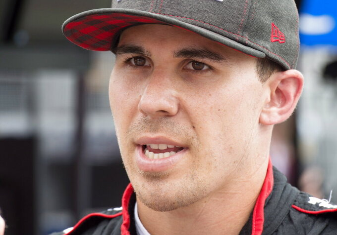 FILE - In this July 13, 2018 file photo, Robert Wickens talks after the second practice session for the Toronto Indy IndyCar auto race in Toronto. IndyCar drivers are returning to Pocono Raceway in a somber frame of mind. Promising rookie Robert Wickens was paralyzed from the waist down in a horrific crash last year.  (Frank Gunn/The Canadian Press via AP)