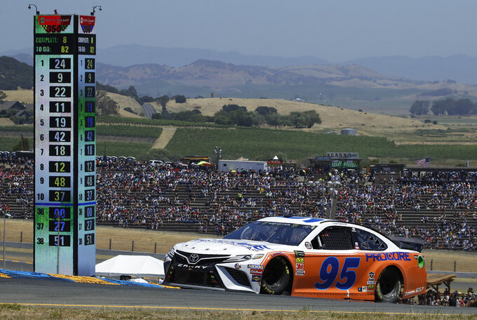 In this photo taken Sunday, June 23, 2019, NASCAR Cup Series driver Matt DiBenedetto (95) competes during a NASCAR Sprint Cup Series auto race in Sonoma, Calif. DiBenedetto drove his Leavine Family Racing Toyota to his first top-five finish in the 156th career start of a career spent with underfunded, back-of-the-pack teams. (AP Photo/Ben Margot)